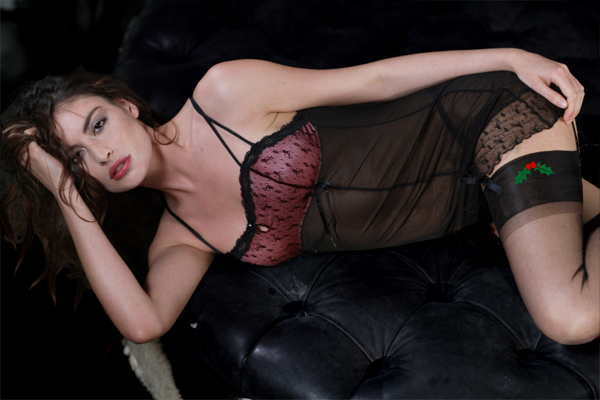 """Holly Mistletoe Top Sheer Stockings"" from StockinGirl ($29.99).  Available in sizes S-2XL."