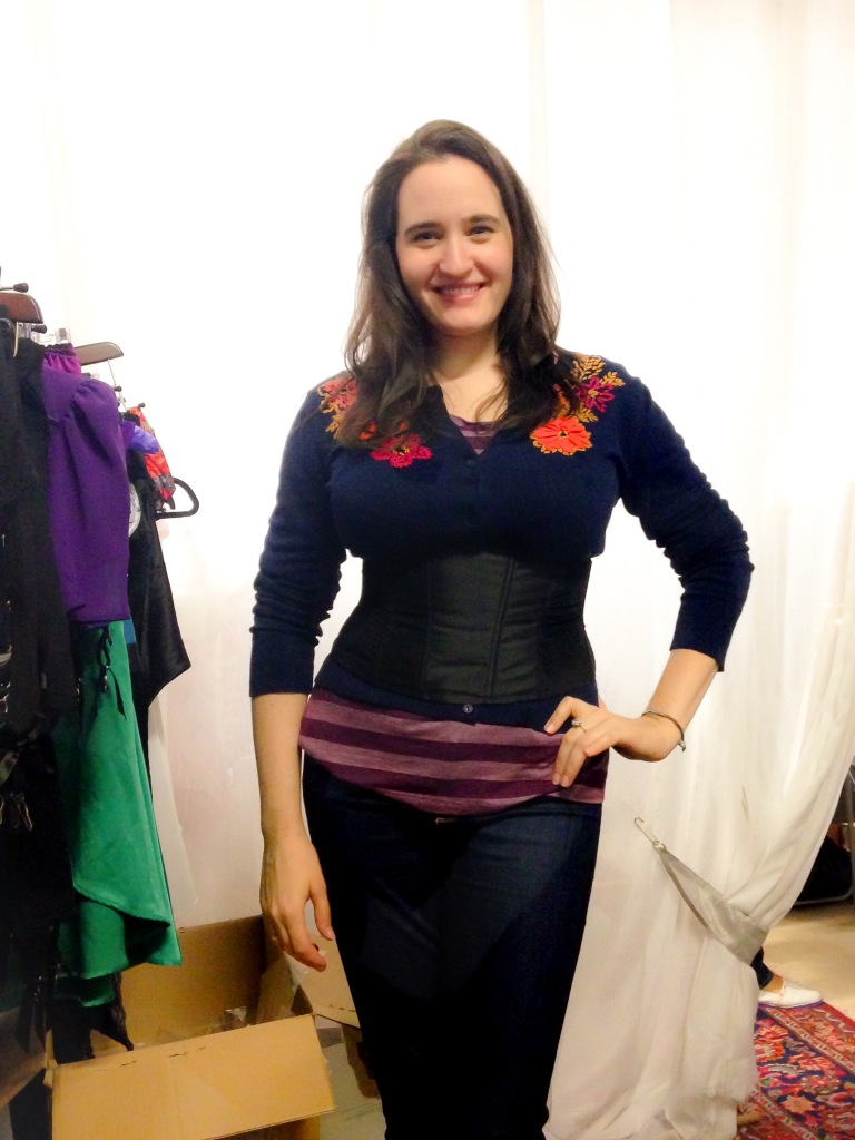 """Kiss Me Deadly's """"Day Corset"""": an underbust corset that features a zipper and stretch panels in addition to lacing and non-stretch panels. You'll still get some waist reduction, but it offers a little more flexibility, especially if you're not used to a traditional boned corset."""