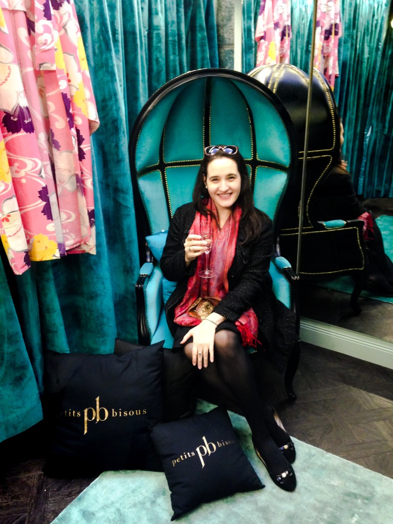In one of the dressing rooms at Petits Bisous, seated in my new favorite piece of furniture.
